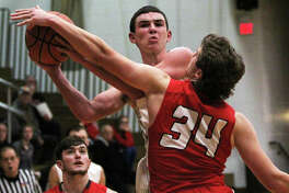 Calhoun's Drew Baalman scored 21 points the Class 1A regional championship game Friday night n Hardin against Madison, but his team saw its season come to an end with a 66-54 loss to the Trojans. Baalman is shown in action earlier this season against Staunton.