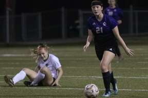 In this file photo, Montgomery senior Ashton Jilek (21) dribbles down field after out maneuvering Kingwood Park senior Claire Jimerson (11) during a girls soccer game Tuesday, Jan. 15, 2019 at Montgomery High School in Montgomery.