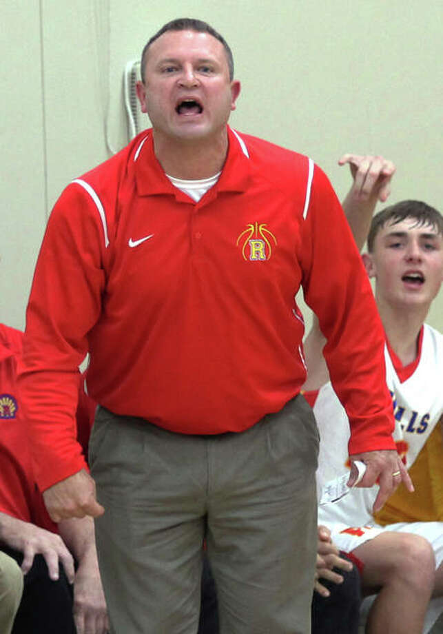 Roxana coach Mark Briggs saw his team hold on for a 50-41 victory over East Alton-Wood River Friday night in Wood River. He is shown giving instructions in a game earlier this season. Photo: Telegraph File Photo