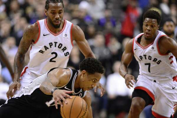 DeMar DeRozan loses the ball under pressure from ex-Spur Kawhi Leonard, who converted the turnover into a dunk to put Toronto up for good with 15 seconds left.
