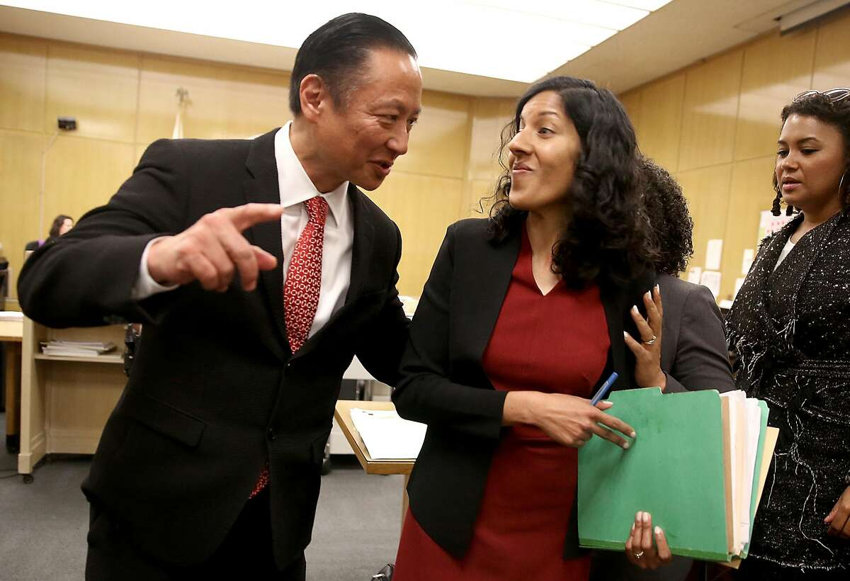 SF public defender Jeff Adachi (left) talks with deputy public defender Anita Nabha (right) who represented robbery suspect Kenneth Humphrey about his release at Hall of Justice on Thursday, May 3, 2018, in San Francisco, Calif.