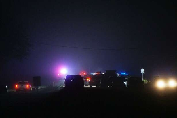 Officials investigate the scene of a shooting in Poteet in which a Texas Department of Safety trooper shot and killed a suspect in the stabbing of a man in Poteet and another man in Jourdanton.