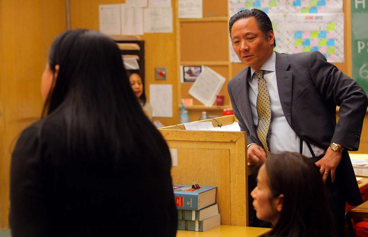 Public Defender Jeff Adachi, right, listens as Chief Assistant District Attorney Sharon Woo argues against Adachi being allowed to defend Binh Thai Luc in court at the Hall of Justice on Thursday, March 29, 2012 in San Francisco. Luc is in custody for allegedly killing five people last Friday at the house at 16 Howth St.