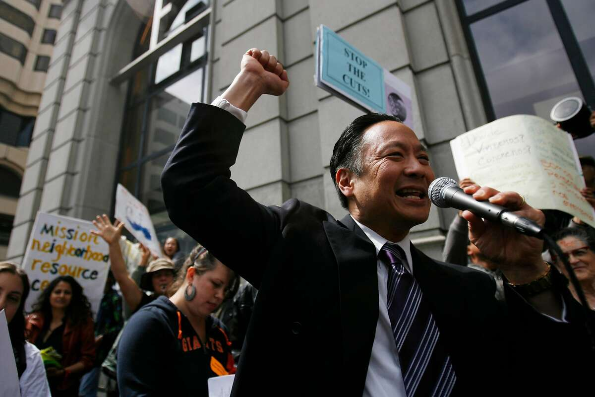San Francisco Public Defender Jeff Adachi, center, speaks to a group of demonstrators in Hallidie Plaza prior to a march toward City Hall in protest of Mayor Gavin Newsom's budget in Downtown San Francisco on Wednesday, June 10, 2009.