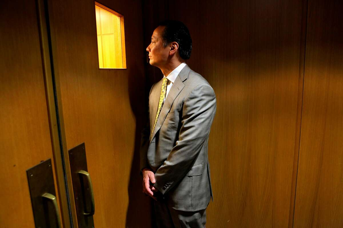 San Francisco Public Defender Jeff Adachi looks through the window into the courtroom to check on the preceding at the Hall of Justice, Tuesday Sept. 29, 2010, in San Francisco, Calif.