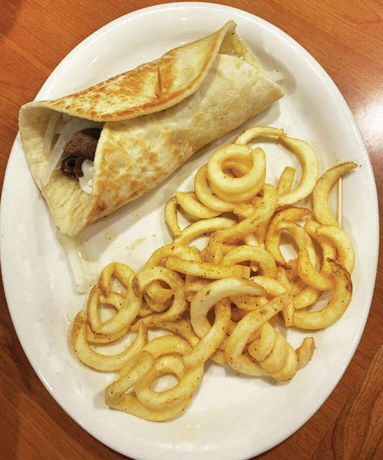 "The ""Original Olga"" served with seasoned curly fries"