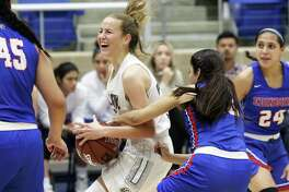 Cougar guard Hailey Adams draws a foul after splitting the defense into the lane as Clark plays Edinburg in the Region IV-6A girls basketball tournament at Northside Gym on February 22, 2019.