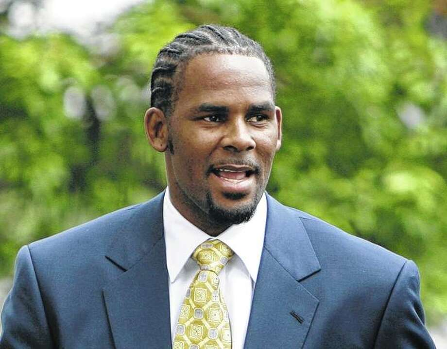 R&B singer R. Kelly arrives in June 2008 at the Cook County Criminal Court Building in Chicago. The R&B star, who has been trailed for decades by allegations that he violated underage girls and women and held some as virtual slaves, was charged Friday with aggravated sexual abuse involving four victims, including at least three between the ages of 13 and 17. Photo: M. Spencer Green | Associated Press