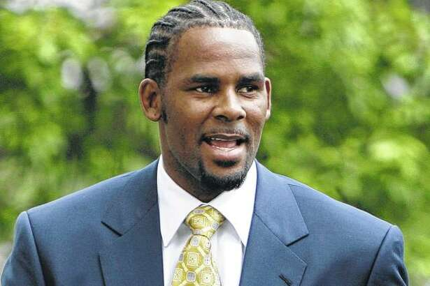 R&B singer R. Kelly arrives in June 2008 at the Cook County Criminal Court Building in Chicago. The R&B star, who has been trailed for decades by allegations that he violated underage girls and women and held some as virtual slaves, was charged Friday with aggravated sexual abuse involving four victims, including at least three between the ages of 13 and 17.