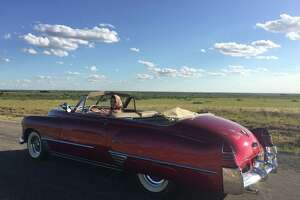 "A classic cherry-red Cadillac in ""The Iron Orchard"" belongs to David Arrington of Midland."