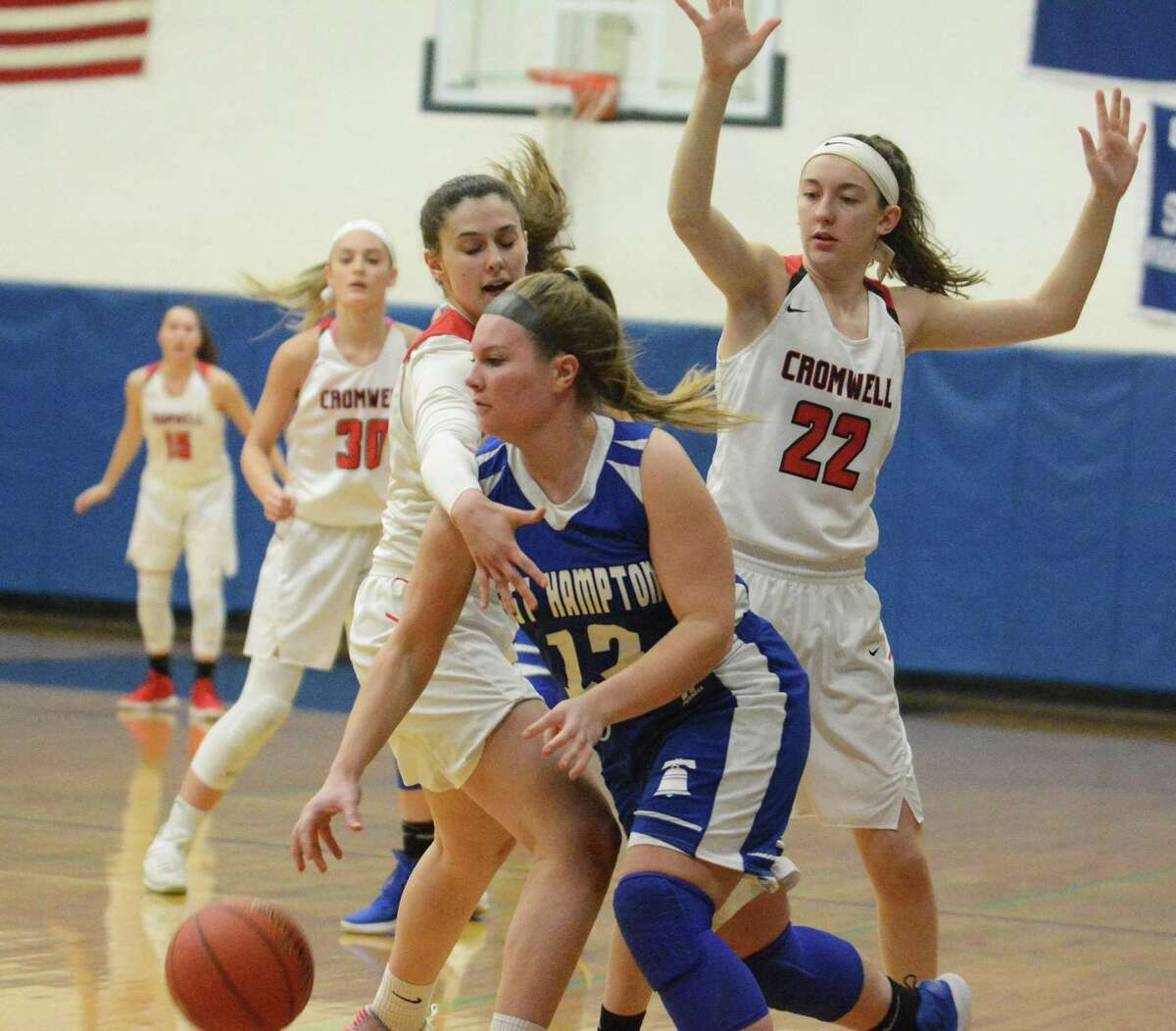 East Hampton's Rachel Vickery is surrounded by Cromwell's Najla Cecunjanin and Jessica DellaRatta (22) during Friday's Shoreline Conference championship game.