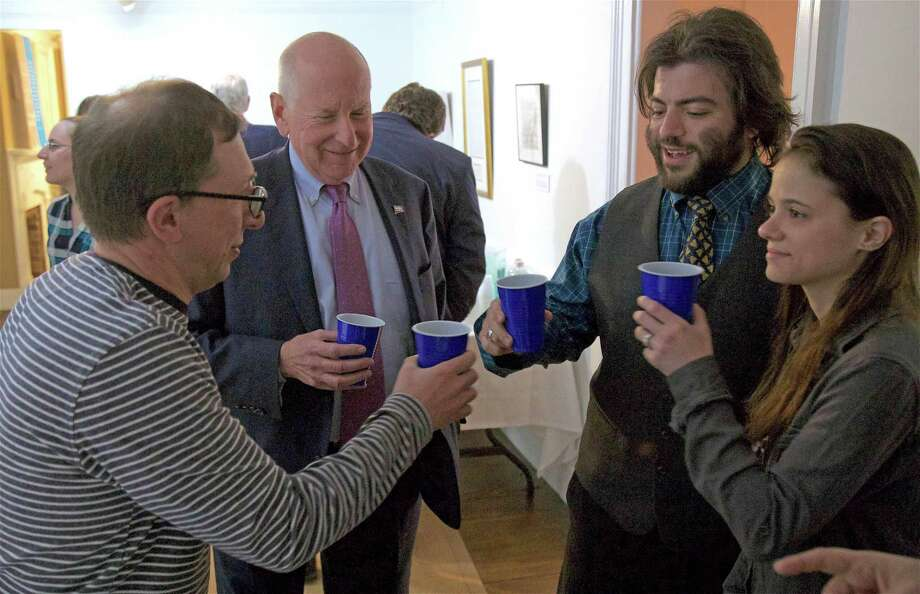 """Toasting are, from left, Sal Liccione, First Selectman Jim Marpe, and T.J. Elgin and Denise Bahr, all of Westport, at the Westport Historical Society's """"Ale to the Chief"""" event on Friday, Feb. 22, 2019, in Westport, Conn. Photo: Jarret Liotta / For Hearst Connecticut Media / Westport News Freelance"""