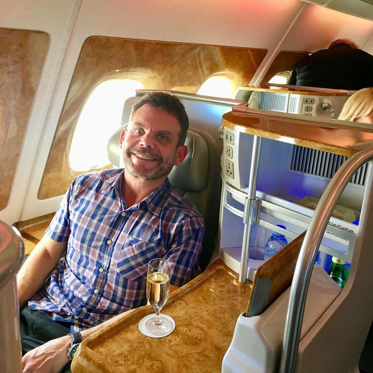 Reader Jason Vaudrey redeemed 210,000 Alaska Airlines miles for a ride in Emirates business class- this is the new version pictured- note the wood paneling- SEE SLIDESHOW at the top of this post for more photos