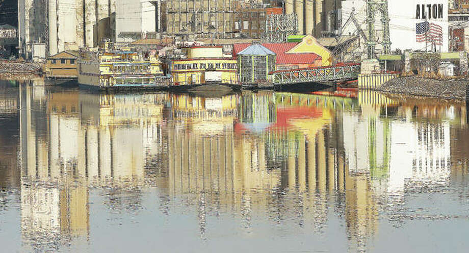 The colorful Argosy Casino is reflected in the still waters of a very calm Mississippi River this week. It doesn't happen often, but a calm river and no wind sometimes gives the river a mirror effect. Photo: John Badman | The Telegraph