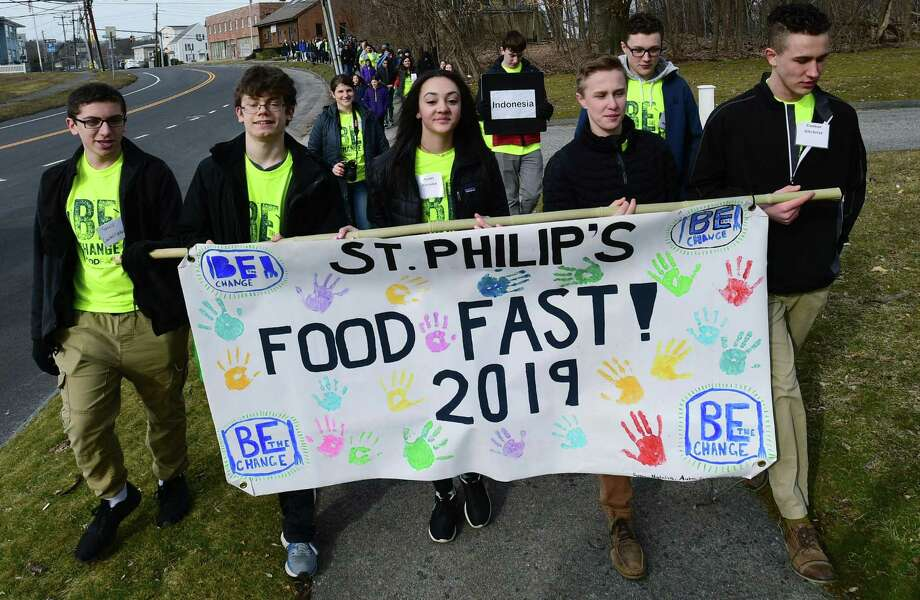 Michael Castellano, Dylan Consolati, Aubri Ancona, Ryan Gilchrist and Connor Gilchrist lead the Peace March from St. Philip School to the Church as St. Philip Church holds its annual hunger awareness event 'FoodFast - Be the Change' Saturday, February 23, 2019, to help raise awareness and funds for Eradication of World Hunger in Norwalk, Conn. Over 50 teens from local area parishes and middle/high schools participated in the daylong event. Photo: Erik Trautmann / Hearst Connecticut Media / Norwalk Hour