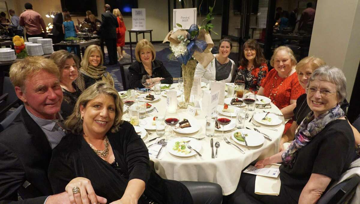 From left: Susan & John Meinholz, Judy Cox, Bonnie Longnion, Belinda Zoet, Charlotte Reinemeyer, Deborah Mowrey, Tracy Brown, Jane Leckey and Barbara Madera make up the Friends of HAAM tableat the Pillars of the Community banquet on Feb. 22, 2019 at the Clubs of Kingwood's Kingwood clubhouse.