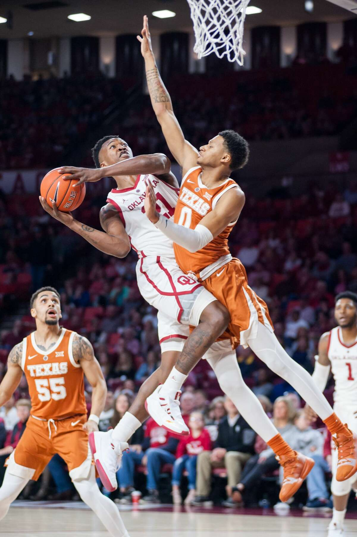NORMAN, OK - FEBRUARY 23: Oklahoma Sooners (21) Kristian Doolittle going up for two points while Texas (0) Gerald Liddell plays defense on February 23, 2019, at the Lloyd Noble Center in Norman, Oklahoma (Photo by Torrey Purvey/Icon Sportswire via Getty Images)