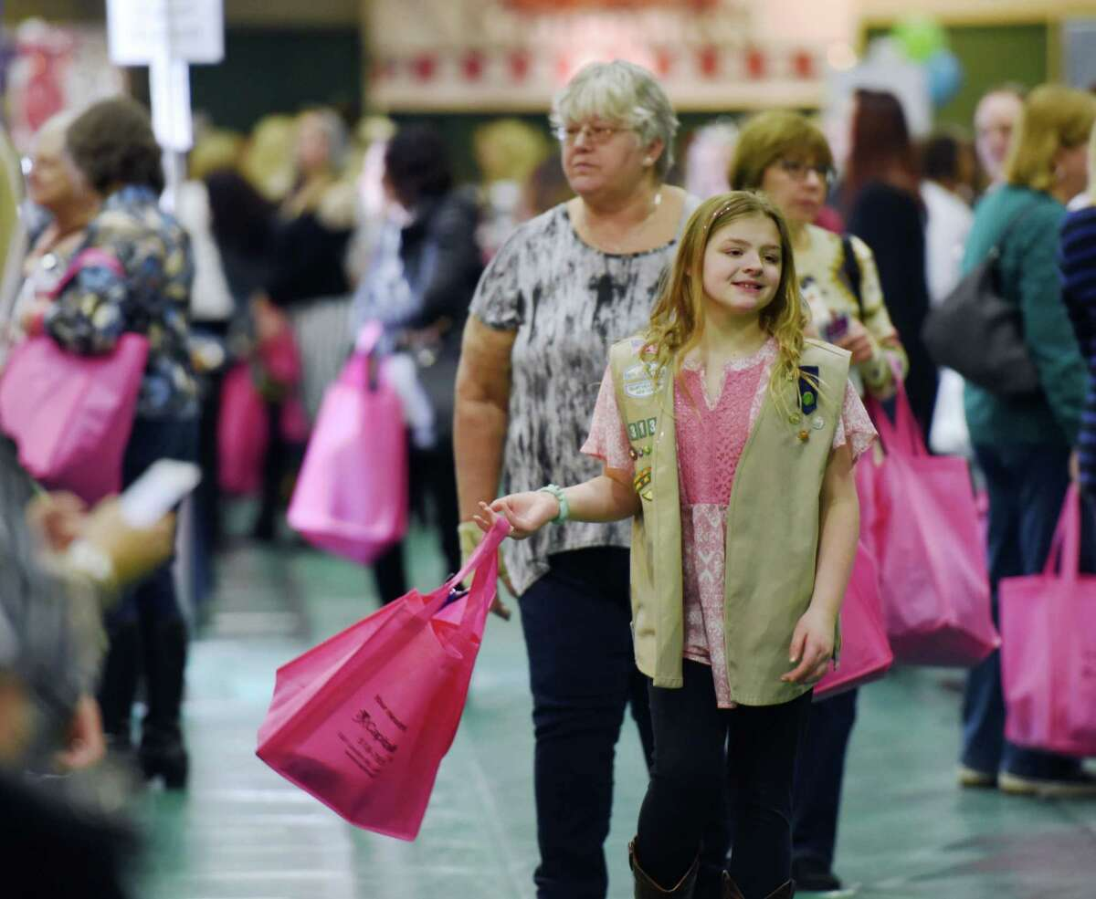 Marisa Shannon, 11, and her grandmother, Christina Searles, walk through the New York Women's Expo on Saturday, Feb. 23, 2019 at Siena College in Loudonville, NY. (Phoebe Sheehan/Times Union)