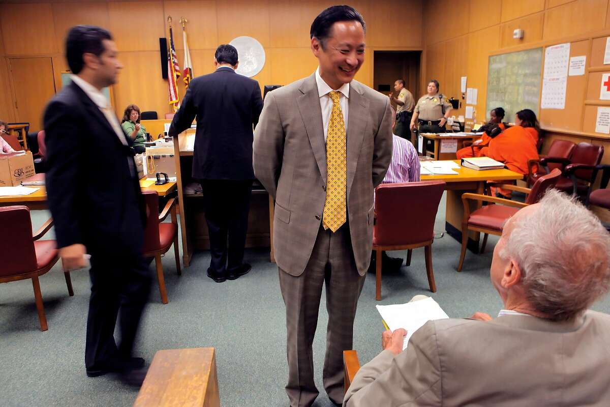 San Francisco Public Defender Jeff Adachi meets a friend as he stops into court to check on some of his staff at the Hall of Justice, Tuesday Sept. 29, 2010, in San Francisco, Calif.