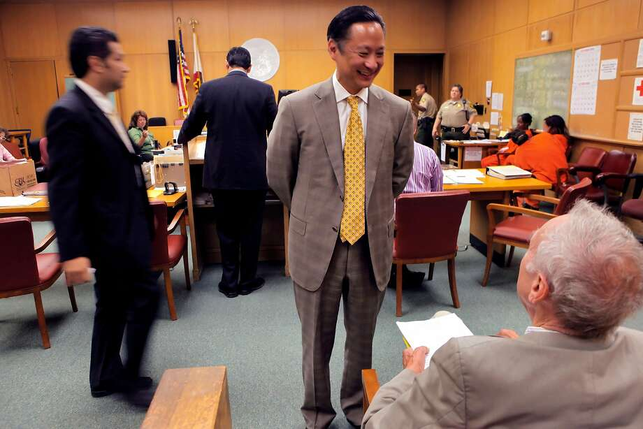 San Francisco Public Defender Jeff Adachi meets a friend as he stops into court to check on some of his staff at the Hall of Justice, Tuesday Sept. 29, 2010, in San Francisco, Calif. Photo: Lacy Atkins / The Chronicle