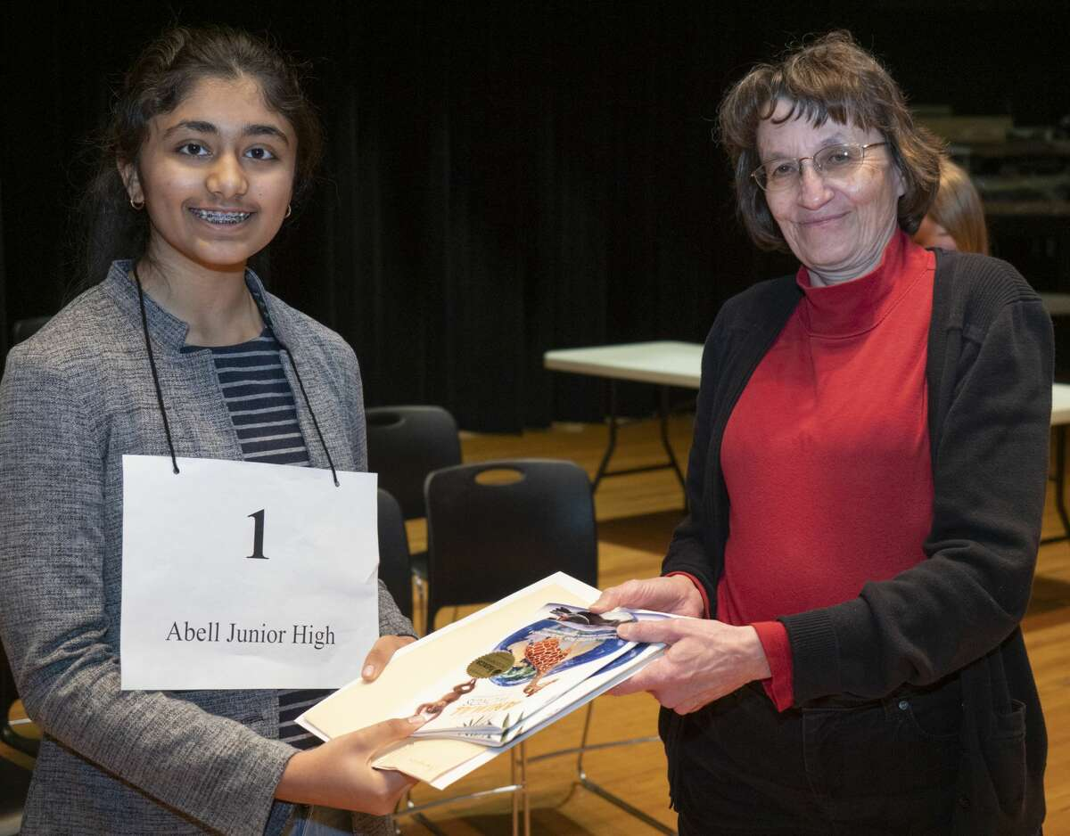 Mary Dearen, Midland Reporter managing editor, awards first place to Amulya Ganta from Abell Junior High 02/23/2019 during the 32nd annual Spelling Bee. Tim Fischer/Reporter-Telegram