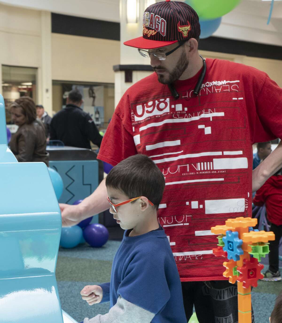 Alex Valle and his son A.J. work together on the gears builder 02/23/2019 in the new play area in Midland Park Mall near JCPenny. Tim Fischer/Reporter-Telegram