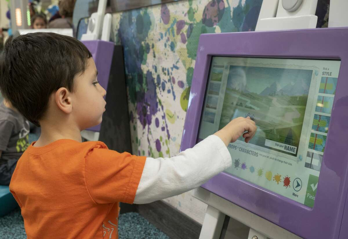 Jaden Rush, 4, plays on one of the interactive displays 02/23/2019 in the new play area in Midland Park Mall near JCPenny. Tim Fischer/Reporter-Telegram