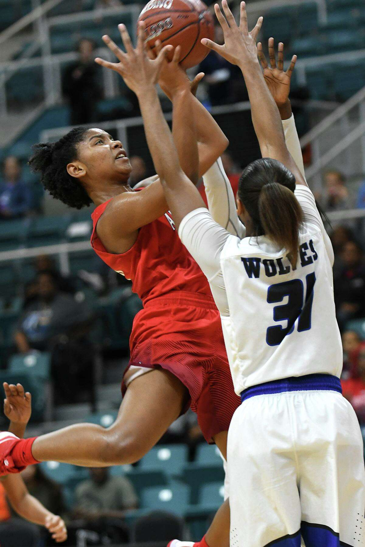 Atascocita sophomore guard Robin Whitehead (10) skies for a shot over Westside senior forward Jessica Soders (31) during the 4th quarter of their UIL Region III-6A Girls Basketball Semi-final matchup at the Merrell Center in Katy on Feb. 22, 2019.