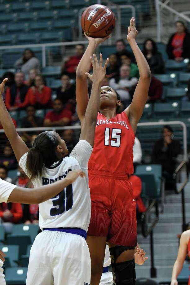 Atascocita junior post Elyssa Coleman (15) sets for a shot over Westside senior forward Jessica Soders (31) during the 3rd quarter of their UIL Region III-6A Girls Basketball Semi-final matchup at the Merrell Center in Katy on Feb. 22, 2019. Photo: Jerry Baker, Houston Chronicle / Contributor / Houston Chronicle