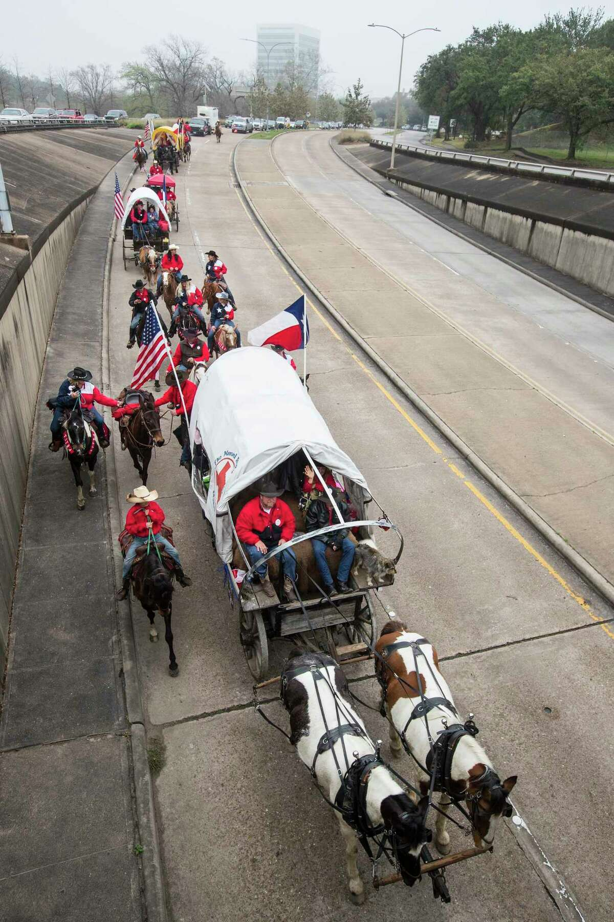For many Texans, the sight of hundreds of horseback riders and covered wagons making their way down state highways into Houston is a heartfelt reminder that rodeo season has officially begun. Original caption: The Texas Independence Trail Ride travels along Allen Parkway as they make their way to Memorial Park to help kick off the annual Houston Livestock Show and Rodeo on Friday, Feb. 22, 2019, in Houston.