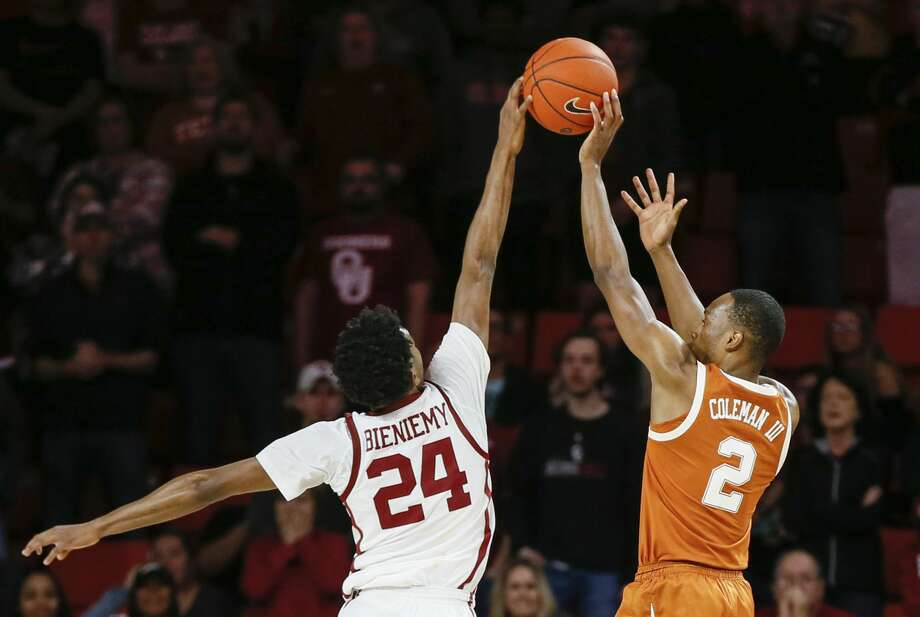 Oklahoma's Jamal Bieniemy (24) blocks a last-second shot by Texas' Matt Coleman III (2) during the second half of an NCAA college basketball game in Norman, Okla., Saturday, Feb. 23, 2019. Oklahoma won 69-67. (Nate Billings/The Oklahoman via AP) Photo: NATE BILLINGS/Associated Press