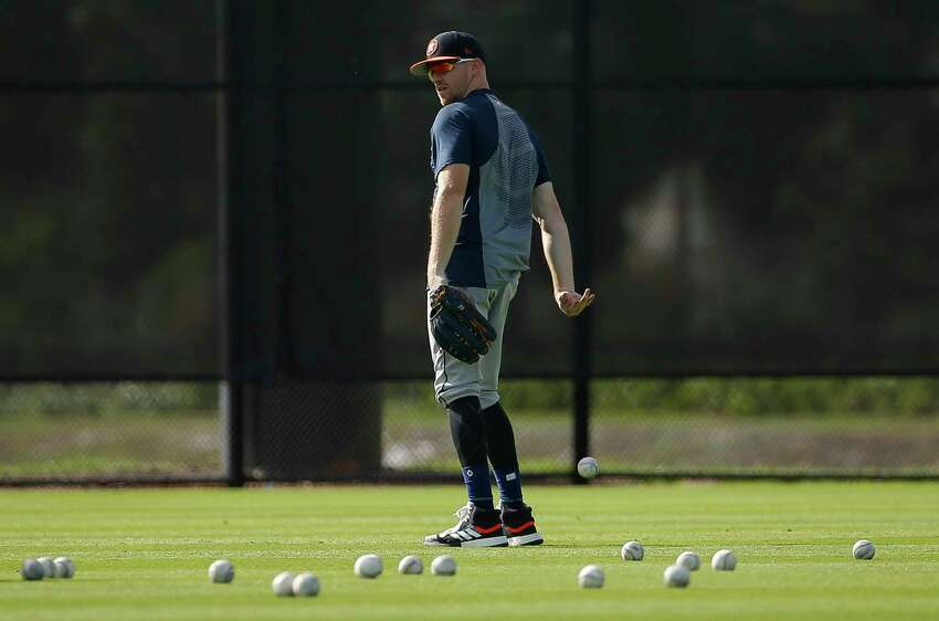 Houston Astros left fielder Derek Fisher (21) tosses a fly ball he just caught during defense drill at Fitteam Ballpark of The Palm Beaches on Day 10 of spring training on Saturday, Feb. 23, 2019, in West Palm Beach.