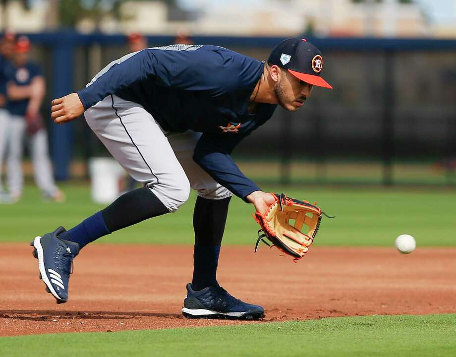 Houston Astros shortstop Carlos Correa (1) catches a ground ball during defense drills at Fitteam Ballpark of The Palm Beaches on Day 10 of spring training on Saturday, Feb. 23, 2019, in West Palm Beach. Photo: Yi-Chin Lee, Staff Photographer / © 2019 Houston Chronicle