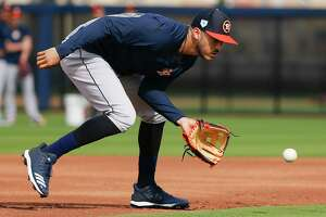 Houston Astros shortstop Carlos Correa (1) catches a ground ball during defense drills at Fitteam Ballpark of The Palm Beaches on Day 10 of spring training on Saturday, Feb. 23, 2019, in West Palm Beach.