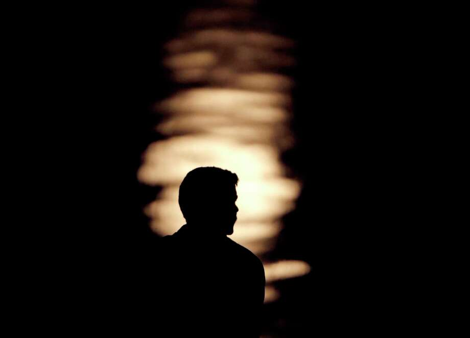 FILE- In this June 27, 2018, file photo a man is silhouetted against moonlight reflecting off the Missouri River as he watches the full moon rise beyond downtown buildings in Kansas City, Mo. Change is constant, especially when you?re young. Chances are you?ll cycle through a few moves, job changes and romantic relationships as you establish your life as a young adult. (AP Photo/Charlie Riedel, File) Photo: Charlie Riedel / Copyright 2018 The Associated Press. All rights reserved.