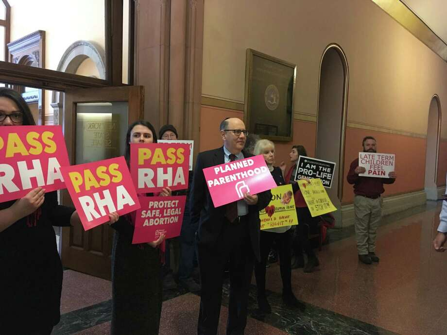 Supporters and opponents of the Reproductive Health Act line up outside a packed Senate Health Committee, which voted 10-5 in favor of enacting the bill on Tuesday, Jan. 22, 2019 in Albany, N.Y. (David Lombardo / Times Union)