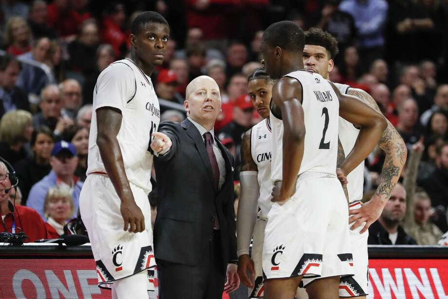 Coach Mick Cronin and Cincinnati take on UConn on Sunday in Hartford. Photo: John Minchillo / Associated Press / Copyright 2019 The Associated Press. All rights reserved.