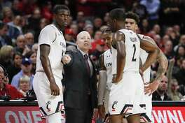 Coach Mick Cronin and Cincinnati take on UConn on Sunday in Hartford.