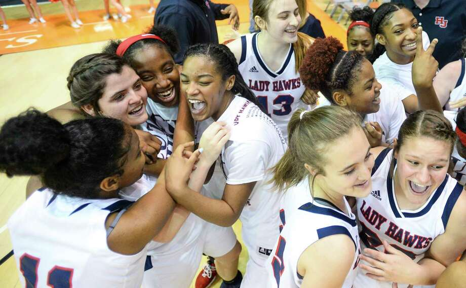 Hardin-Jefferson players react after beating Fairfield 64 to 40 in the regional finals playoff game at Sam Houston State University on Saturday. Photo taken on Saturday, 02/23/19. Ryan Welch/The Enterprise Photo: Ryan Welch, The Enterprise / ©Ryan Welch