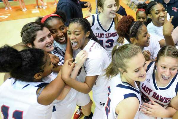 Hardin-Jefferson?•s players react after beating Fairfield 64 to 40 in the regional finals playoff game at Sam Houston State University on Saturday. Photo taken on Saturday, 02/23/19. Ryan Welch/The Enterprise