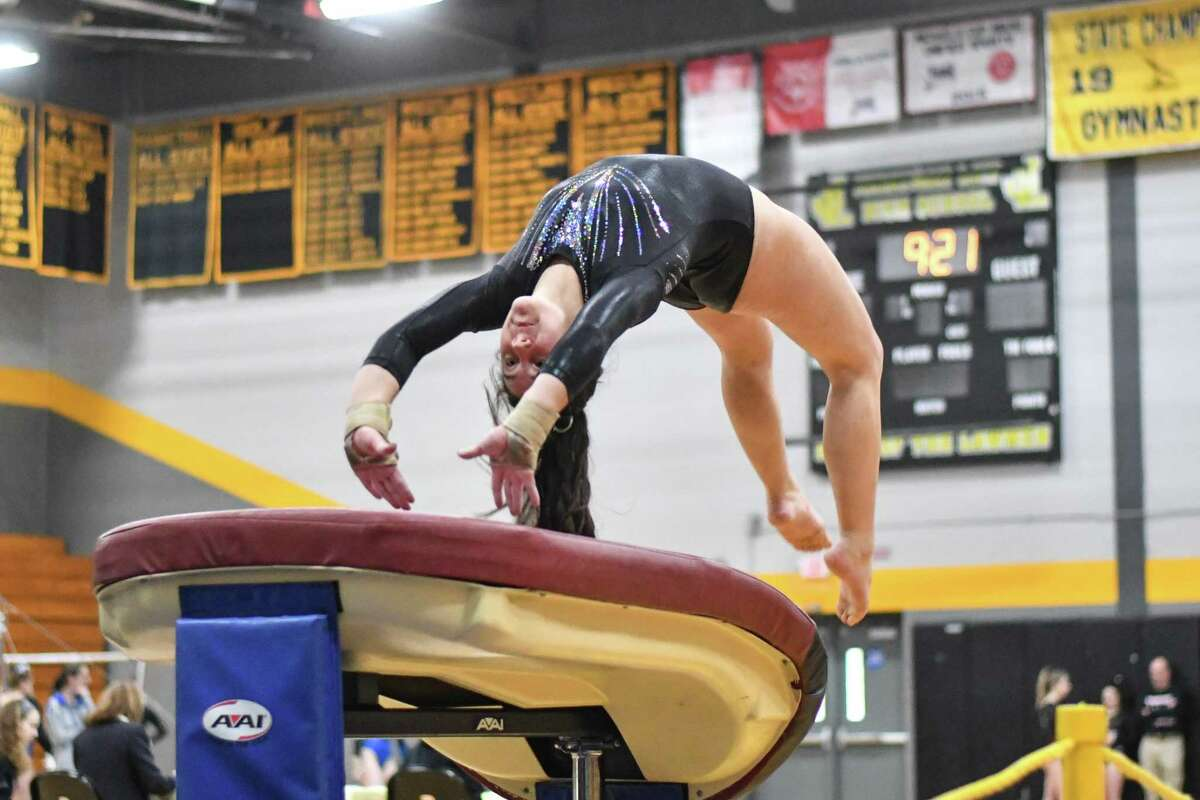 Maggie McMeon of Killingly/Putnam/Tourtellotte competes on the vault during the CIAC Class M Gymnastics Championships on Saturday February 23, 2019 at Jonathan Law High School in Milford, Connecticut.