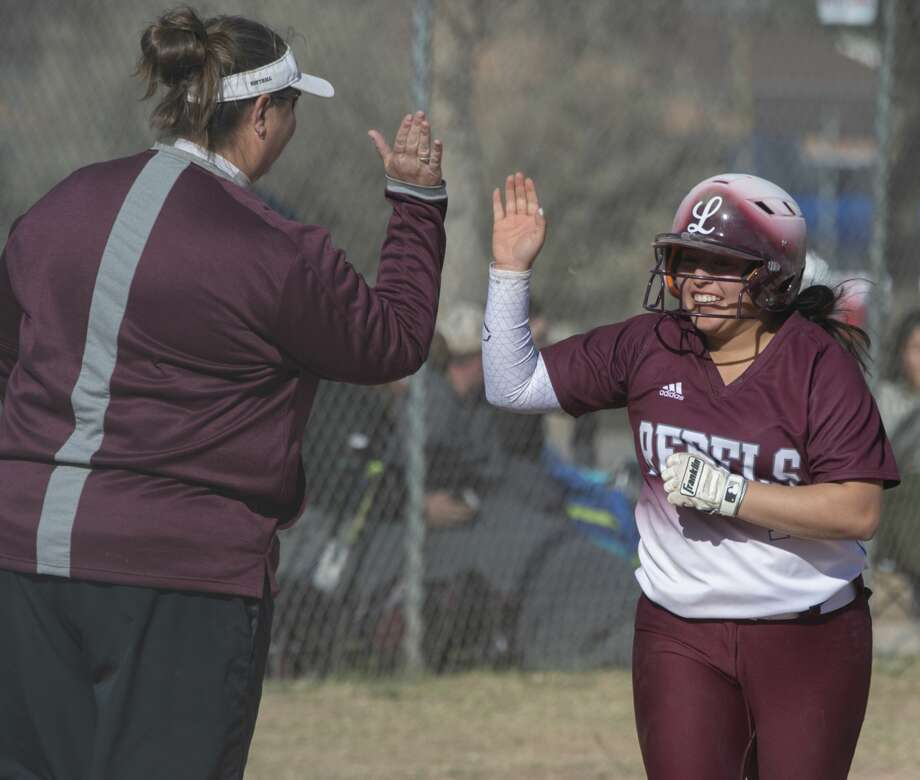 Midland Lee's Emily Gonzalez gets a high five from Coach Mandy Davis as she rounds third on a three-run home run 02/23/2019 in a match against Amarillo High at the West Texas Classic. Tim Fischer/Reporter-Telegram Photo: Tim Fischer