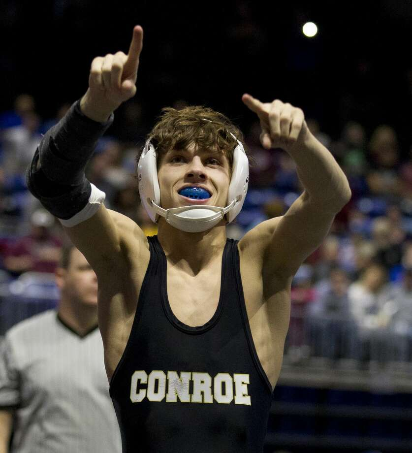 Wyatt Maturin of Conroe reacts after defeating Carson Laughery of Austin Lake Travis for bronze in the Class 6A boys 106-pound division during the UIL State Wrestling Championships at the Berry Center, Saturday, Feb. 23, 2019, in Cypress. Photo: Jason Fochtman/Staff Photographer