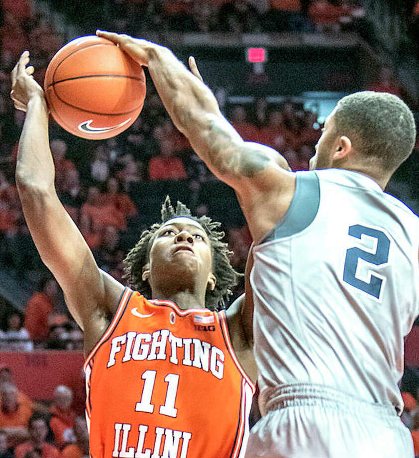 Illinois guard Ayo Dosunmu (11) has a shot knocked by Penn State's Myles Dread in the second half of Saturday's game game in Champaign. Photo: AP Photo