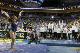 UCLA teammates cheer Margzetta Frazier's uneven bars routine at this month's meet against Arizona State. Frazier opted out of a competitive path that could have put her in position to compete at the 2020 Olympics.