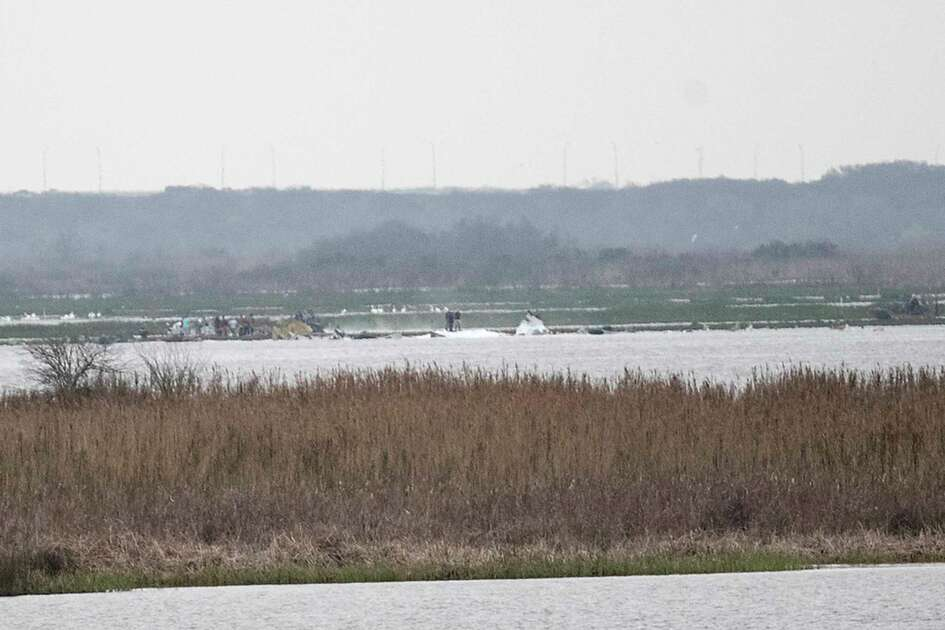 Emergency personnel work the scene of a plane crash site in Trinity Bay on Saturday, Feb. 23, 2019, in Anahuac. The Federal Aviation Administration said a Boeing 767 cargo plane went down shortly before 12:45 p.m., which is approximately 30 miles southeast of George Bush Intercontinental Airport.
