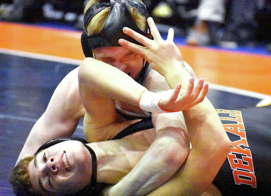 Edwardsville's Noah Surtin, top, in action in his 120-pound match against DeKalb at the Class 3A state tournament quarterfinals Saturday in Bloomington. Photo: Matt Kamp | For The Telegraph