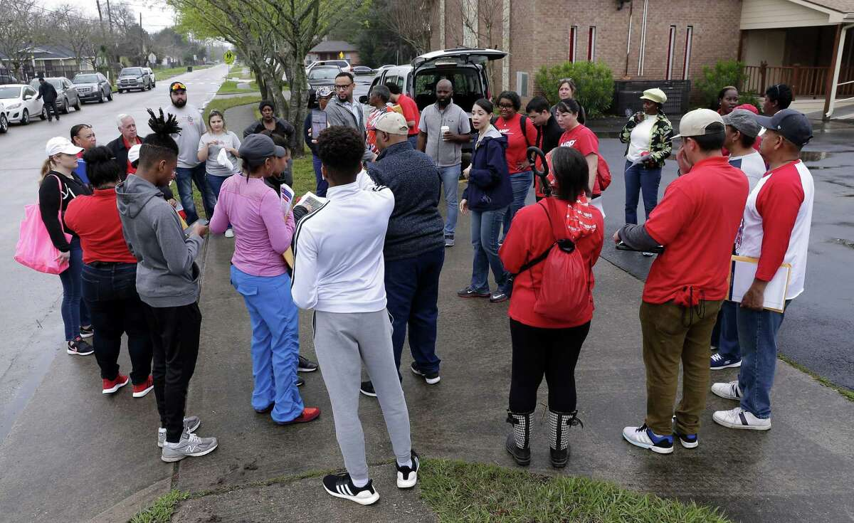 Houston city council member Amanda K. Edwards, center in blue jacket, gives instructions to staff and volunteers before they head out in groups to canvas house affected by the floods of Hurricane Harvey in the Kashmere Gardens neighborhood Saturday, Feb. 23, 2019 in Houston, TX.