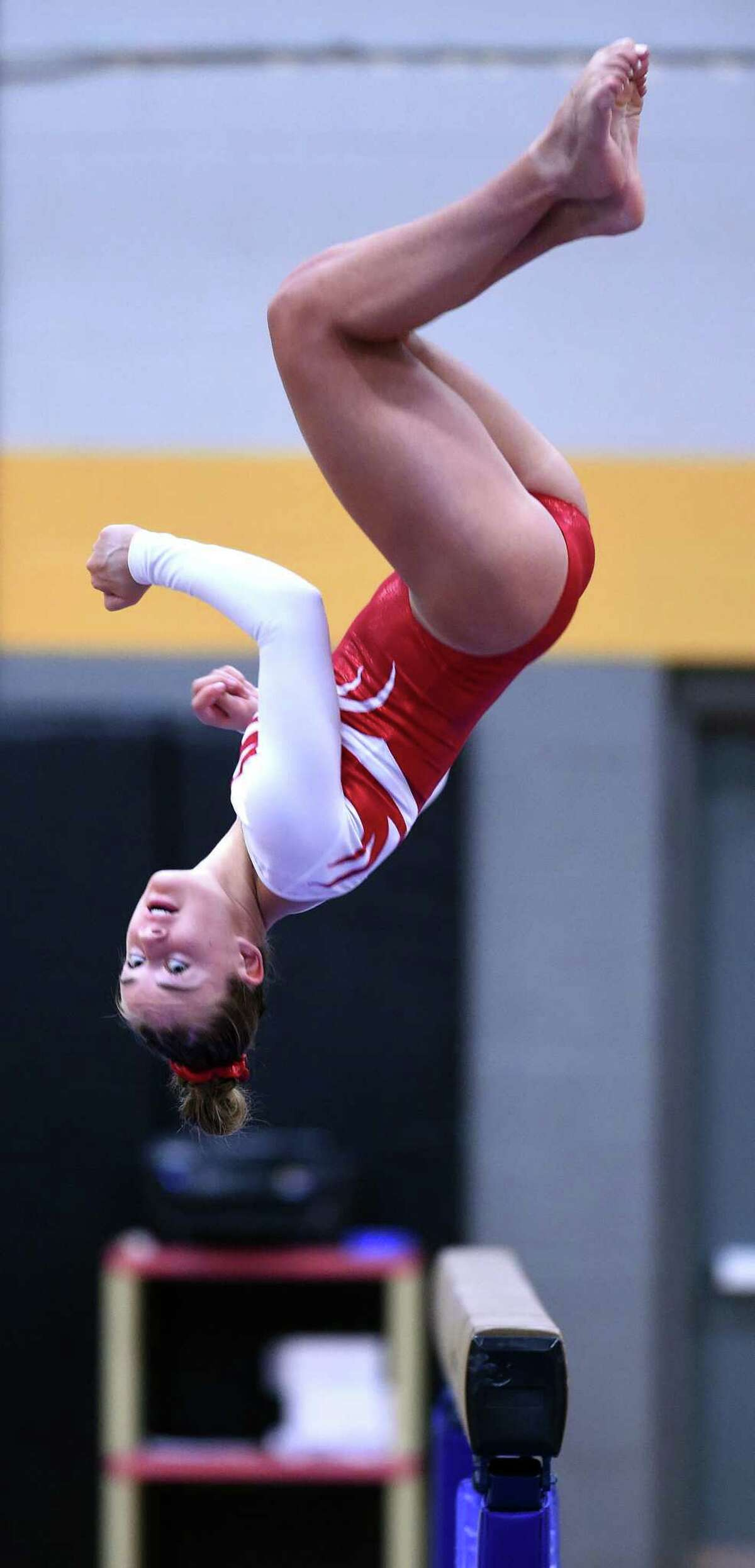 Greenwich's Kelsey Fedorko competes on the beam at Saturday's Class L state championship meet.