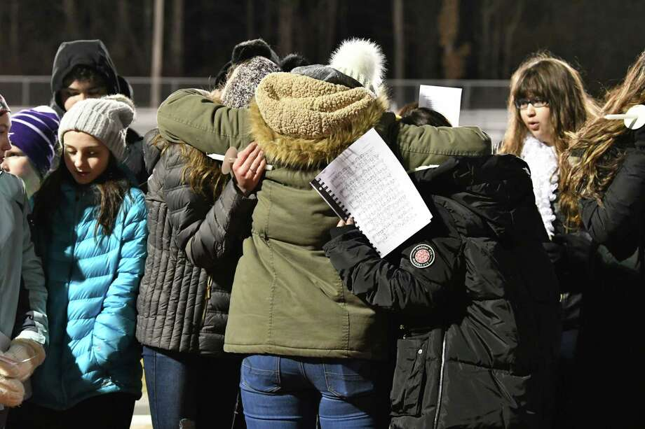 "Classmates get emotional while singing ""Silent Night"" as they attend a vigil to honor seventh-grader Emma Jones at the Ballston Spa High School football field on Tuesday, Dec. 18, 2018 in Ballston Spa, N.Y. Jones was killed as part of what police say was a murder-suicide. (Lori Van Buren/Times Union) Photo: Lori Van Buren / 20045759A"